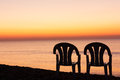 Sunset orange sky background with chair Royalty Free Stock Photo