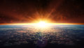 Sunset in orbit with clouds Royalty Free Stock Photo