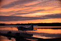 Sunset at an outdoor retreat with a seaplane on a lake near dock Royalty Free Stock Photography