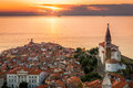 Sunset Over Adriatic Sea and Old Town of Piran, Slovenia Royalty Free Stock Photo