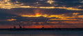 Sunset over the bay with the halo effect panorama Stock Photos