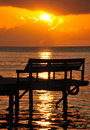 Sunset over bench on pier Royalty Free Stock Photo