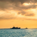 Sunset over blue sea with ship Royalty Free Stock Photo
