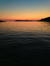 Sunset over calm waters Royalty Free Stock Photography
