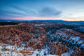 Sunset over canyon slopes covered in snow, Bryce Canyon National Royalty Free Stock Photo