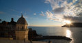 Sunset over cinque terra coastline scenic view of church on of terre vernazza liguria italian riviera Royalty Free Stock Images