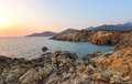 Sunset over cliffs beautiful on the orange of a gulf in corsica Royalty Free Stock Image