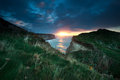 Sunset over cliffs in ocean etretat france Royalty Free Stock Photo