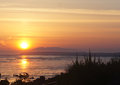 Sunset over cook inlet in anchorage alaska taken from turnagain arm Royalty Free Stock Photo