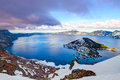 Sunset over crater lake crater lake national park oregon snow covered and wizard island at the caldera is the deepest one in Royalty Free Stock Photo