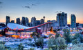 Sunset over downtown calgary and saddledome s skyline with the scotiabank in the foreground the dome with its unique saddle shape Royalty Free Stock Photos