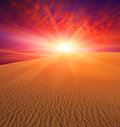 Sunset over dunes sand in deser Stock Image
