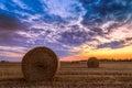 Sunset Over Farm Field With Ha...