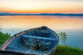 Sunset over Lake Balaton wiht a boat in the front Royalty Free Stock Photo