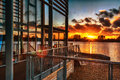 Sunset over lake a with building in the winter Stock Photography