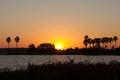 Sunset over lake at dusk background Stock Photo