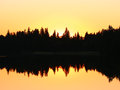 Sunset over the lake in europe forest and contast i Stock Photo
