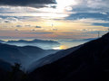 Sunset over the lake maggiore gambarogno switzerland trail of mount gambarogno and views of mountains and Stock Photo