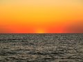 Sunset over lake michigan beautiful filled with reds oranges and yellows setting Stock Image