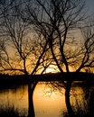 Sunset over a lake an orange and yellow at inks state park in texas Stock Image