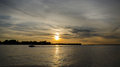 Sunset over lake shore on a cloudy day Royalty Free Stock Photo