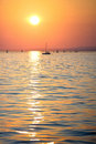 Sunset over the lake sky is bright orange water has an unusual color Royalty Free Stock Images