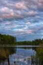Sunset over the lake wonderfull in woodland Royalty Free Stock Image