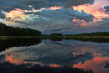 Sunset over the lake wonderfull in woodland Stock Photos