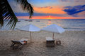 Sunset over Madagascar Nosy be beach with sunlounger Royalty Free Stock Photo