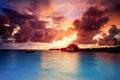 Sunset over maldives islands beautiful beach landscape stunning evening seascape in orange light summer exotic holidays Royalty Free Stock Image