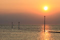 Sunset over morecambe bay at knott end on sea seen from lancashire with the jetty into the river wyre estuary high tide Royalty Free Stock Image