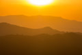 Sunset over mountain range Royalty Free Stock Photo