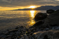 Sunset over the mountains beautiful adriatic sea and in rijeka croatia photographed from beach at winter afternoon Royalty Free Stock Photography