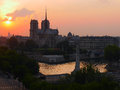 Sunset over notre dame de paris and the seine river most famous cathedral in Royalty Free Stock Photo