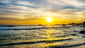 Sunset over the ocean horizon and beach on a nice winter day viewed from Camps Bay Royalty Free Stock Photo