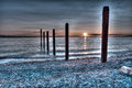 Sunset over the pilings at Point Roberts Royalty Free Stock Photo