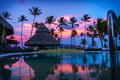 Sunset Over the Pool in a Caribbean Paradise Royalty Free Stock Photo