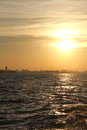 Sunset over the rio de la plata a with city of buenos aires in background Stock Images