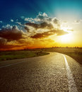 Sunset over road perfect asphalt Stock Photography