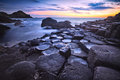 Sunset over rocks formation Giants Causeway, County Antrim, Northern Ireland, UK Royalty Free Stock Photo