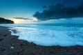 Sunset over rocky beach on atlantic ocean etretat france Stock Photo