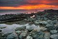Sunset over rocky beach at Koh Lanta island in Thailand. Stock Images