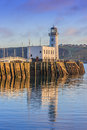 Sunset over scarborough lighthouse north yorkshire Royalty Free Stock Photos