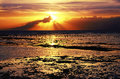 Sunset over sea ebb beautiful seascape pacific ocean sunrise sun sky and clouds bali indonesia Stock Image
