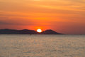 Sunset over the seacoast behind the mountain Royalty Free Stock Photo
