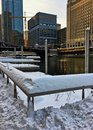 Sunset over a snowy Chicagoland and Chicago River in winter. Royalty Free Stock Photo