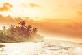 Sunset over tropical beach by Palomino in Colombia Royalty Free Stock Photo