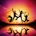 Sunset with People Jumping Royalty Free Stock Photography