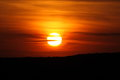 Sunset photo of a large orange sun Royalty Free Stock Photo