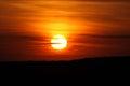Sunset photo of a large orange sun Royalty Free Stock Photo